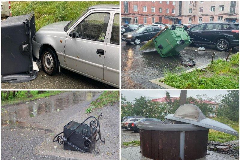 На машины раскидало мусорные баки ветром в Кировске